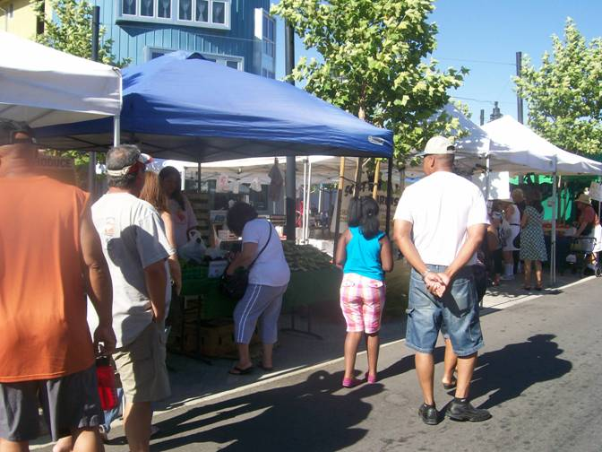 Residents flock to the Farmers Market.
