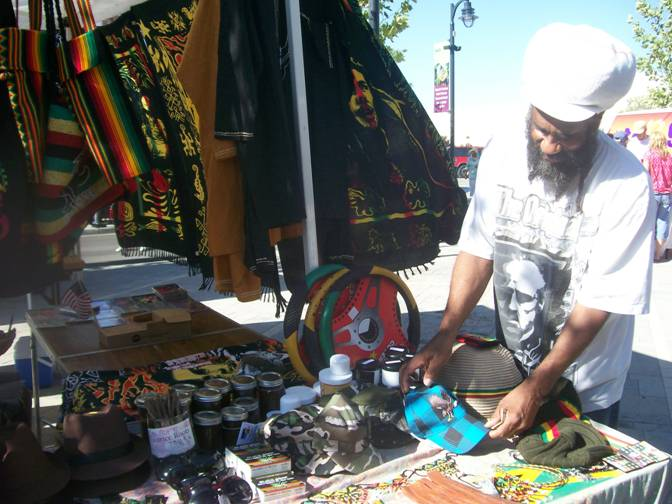 Jah-Fyah, owner of The Mustard Seed Rasta Shop, sells rastarian-inspired merchadise at the Lancaster Farmers Market.