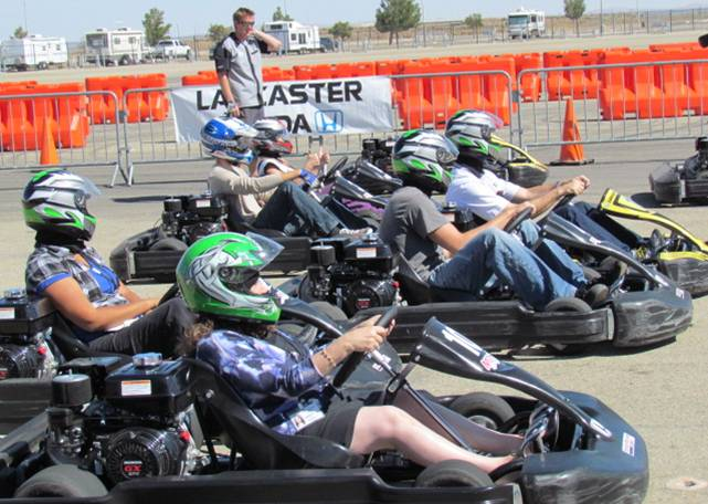 Members of the media test drive the go-karts at the AV Fairgrounds Tuesday.