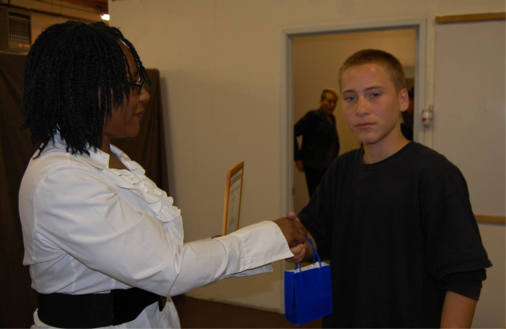 Cynthia Spears congratulates a Change Lanes member on completing the program.