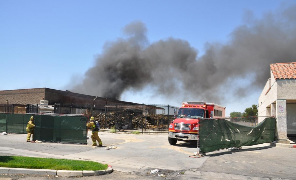 The old H & E Store on Palmdale Boulevard was on fire again Friday afternoon. This building also caught fire last month.