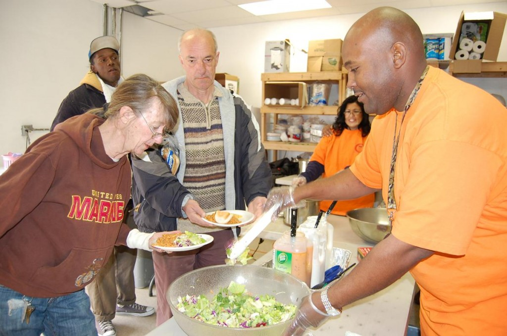 "Weilyn Wingfield, director of ""What Can We Do Foundation"" (right) purchased, prepared and served food to the homeless at St. Vincent de Paul in Lancaster Wednesday morning as part of the city's 6th Annual Martin Luther King Jr. Day of Service."