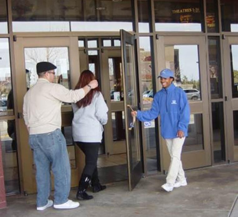 Guys in Blue spotted opening doors for residents at Palmdale Cinemark.