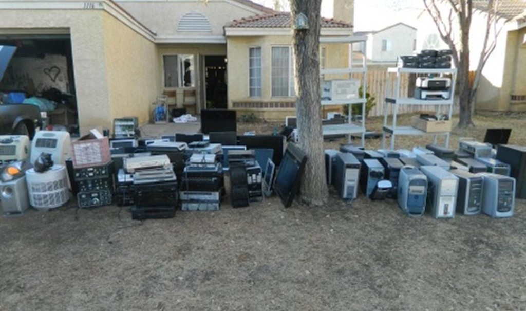 This photo represents only a portion of the stolen electronics that were seized from an east Lancaster home Tuesday morning, authorities said. (LASD)