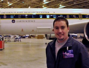 Palmdale teacher Brian Tanner stands in front of a DC-8 aircraft.