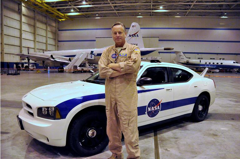NASA pilot Stuart Broce poses in front of a ER-2 Chase Vehicle.