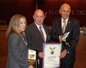Jonsen, with wife Kristi, received a 'Distinguished Service Award.' Kristi is a retired sheriff's lieutenant.
