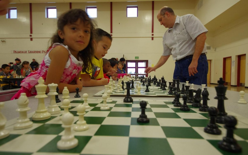 United States Chess Federation National Chess Master Matt Mahowald provides a Simultaneous Exhibition, playing a dozen children at once.