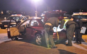 Deputies search a vehicle at the Lancaster DUI checkpoint.