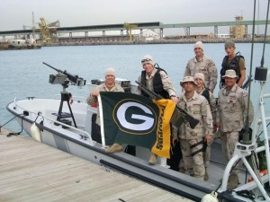 Eric (far left) continued to support of his team while at the Coast Guard Station.
