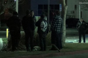 Owner Tully Huffaker and patrons stand outside the club after the shooting.