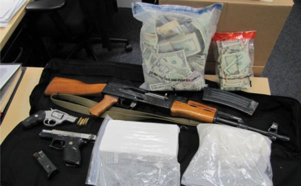 These items were seized from the Lancaster home of alleged gang member John Lawrence Robinson, authorities said. (Courtesy LASD)
