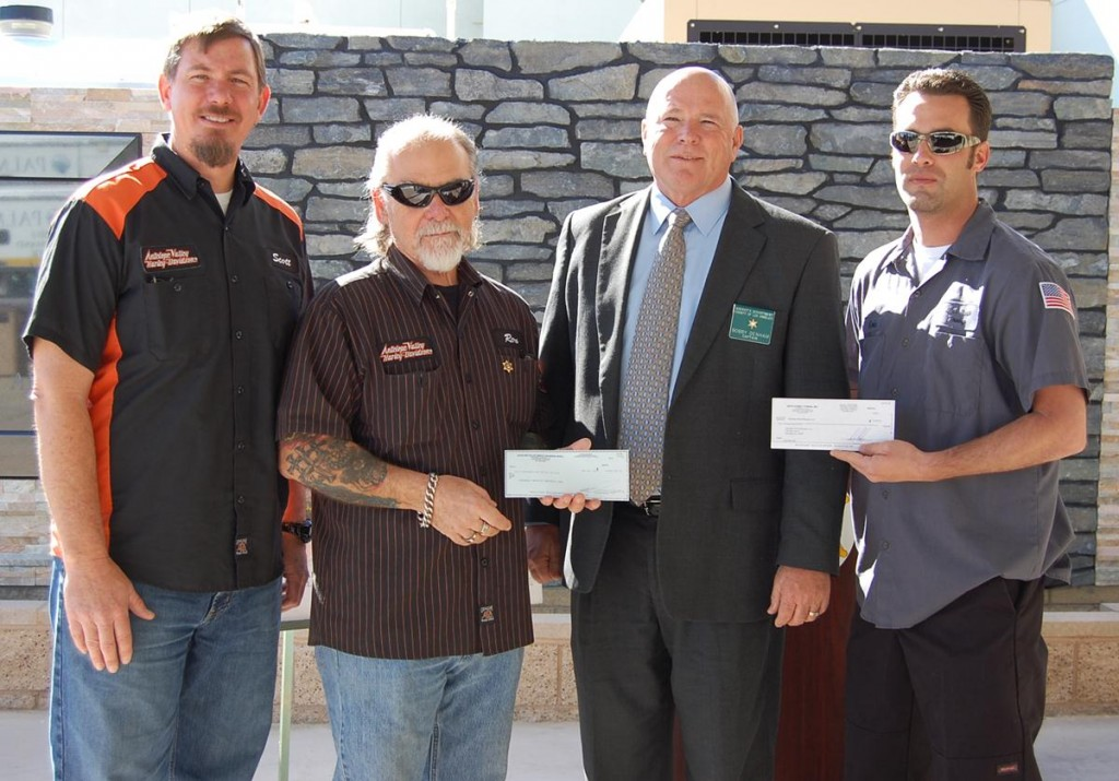 (L to R) Scott Kellerman and Ron Emard of Antelope Valley Harley Davidson, Palmdale Station Captain Bobby Denham, and Eric Mongack of Sixth Street Towing. Antelope Valley Harley Davidson and Sixth Street Towing donated a total of $10,000 to the Palmdale Station Memorial on Wednesday.