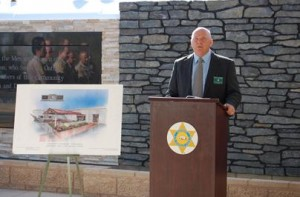Denham said a huge deputy sheriff's star will soon be affixed to the wall behind him.