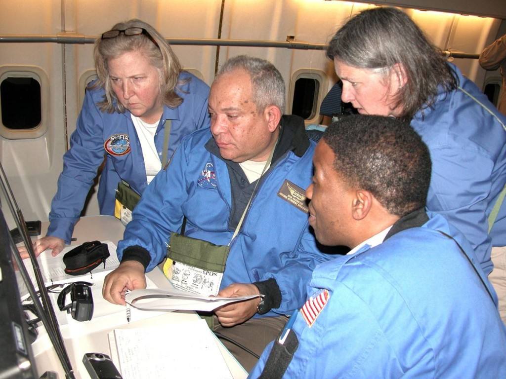 Airborne Astronomy Ambassadors (from left) Constance Gartner, Vince Washington, Ira Hardin and Chelen Johnson at the educators' work station aboard the SOFIA observatory during a flight on the night of Feb. 12-13, 2013. (NASA / Pam Harman)