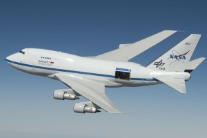 NASA's Stratospheric Observatory for Infrared Astronomy (SOFIA) is shown with its telescope door partly open during a test flight for its astronomical observation mission. (NASA / Jim Ross)
