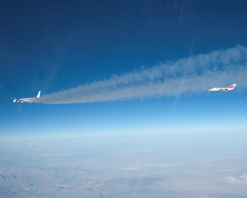 Flying some 500 feet behind NASA's DC-8 flying laboratory, a heavily instrumented HU-25 Falcon measures chemical components of the exhaust streaming from the DC-8's engines burning a 50/50 mix of conventional jet fuel and a plant-based biofuel during the 2013 ACCESS biofuels flight tests. (Image courtesy NASA)