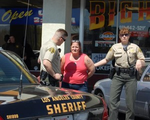 This lady was arrested when authorities searched her name and found a $50,000 narcotics warrant.