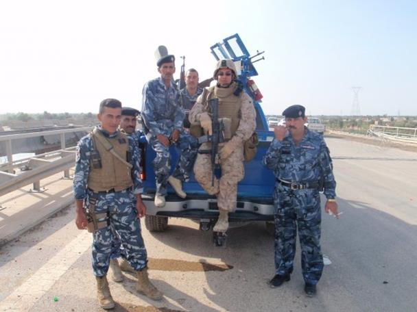 Valley resident and U.S. Marine Sergeant Carlos Ulloa with the Iraqi police force during 'Operation Iraqi Freedom.'