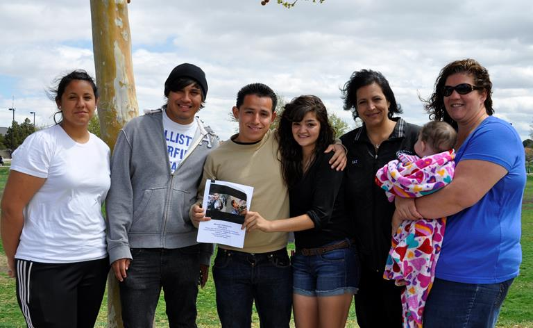 Jackie Perez (far right) and members of the Palmdale Youth Soccer League have led the movement to organize community support for the Valenzuela family.