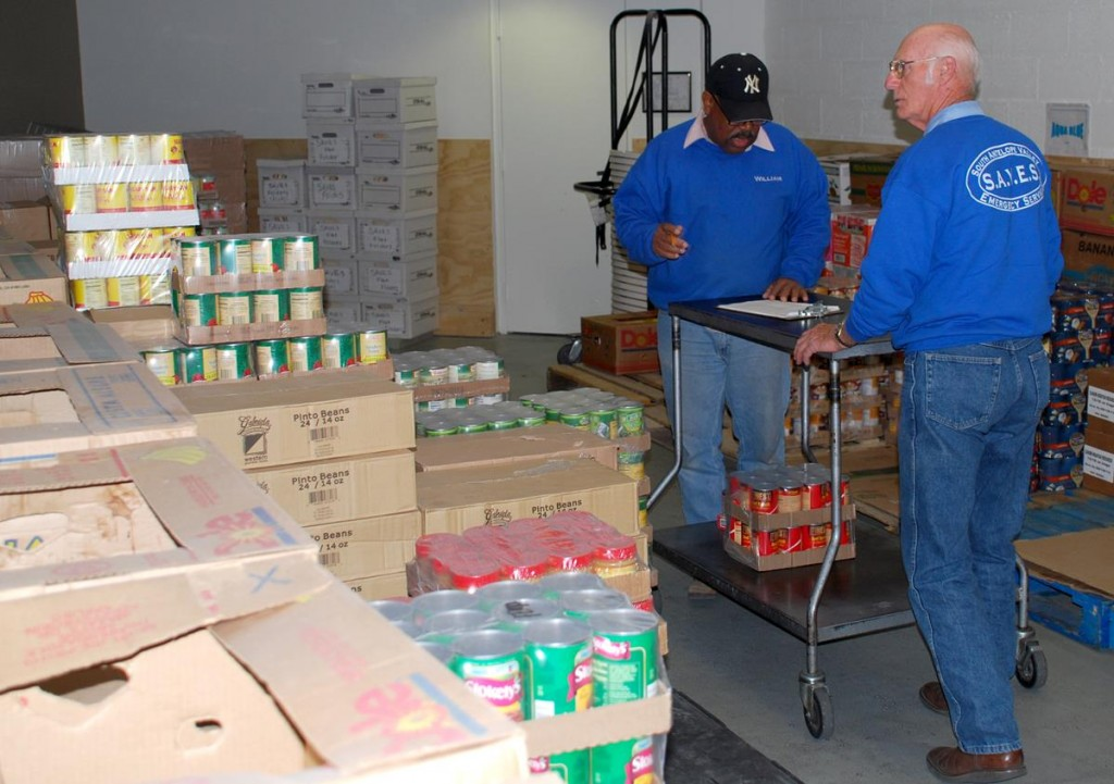 SAVES volunteers help stock donated food items. SAVES raised 9,430 pounds of food during the month of March.