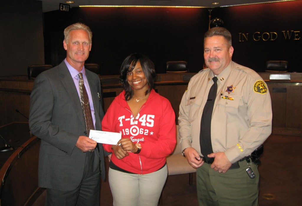 Lancaster Target Manager Skyla Gray (center) presented a $500 check to Lancaster Station Captain Pat Nelson (right) and Lt. Dave Oliva (left) at Lancaster City Hall Thursday afternoon (March 21).