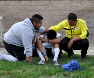 Many soccer players grieved  at the scene.
