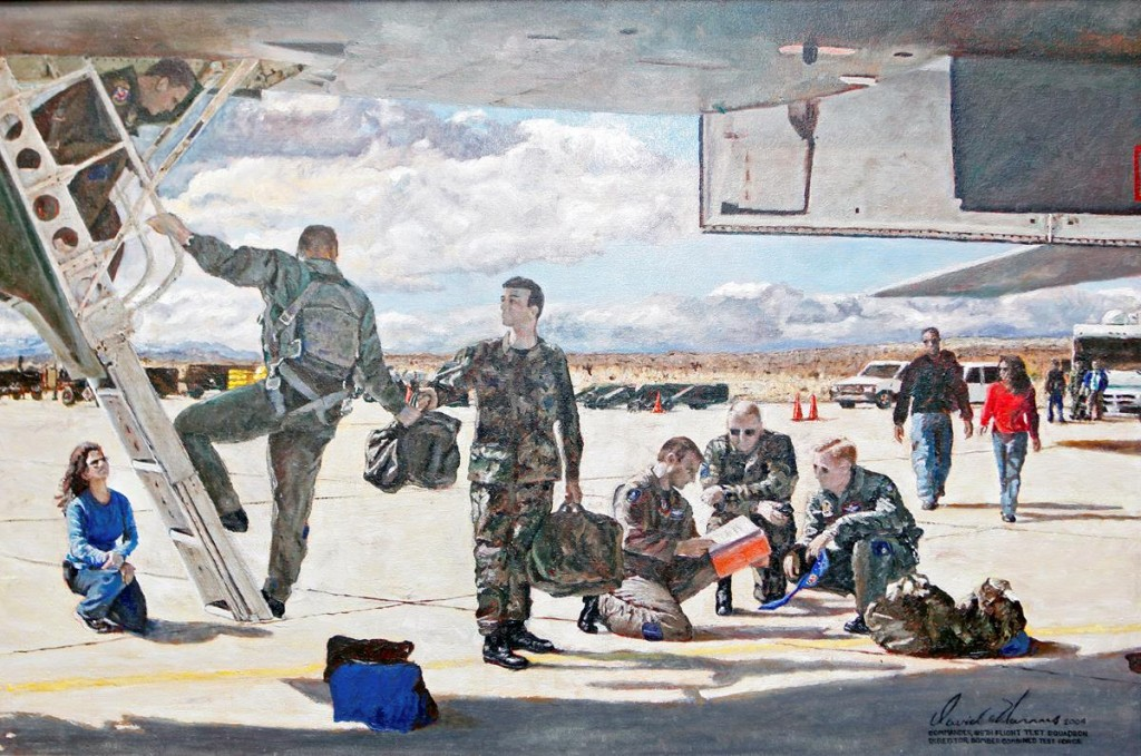 This oil painting, which is currently in the care of the 419th Flight Test Squadron, depicts a variety of Bomber Combined Test Force personnel preparing for a B-1 mission with Tech. Sgt. Chad McBunch's image in the center of the painting handing a helmet bag to a B-1 pilot. (U.S. Air Force photo by Jet Fabara)