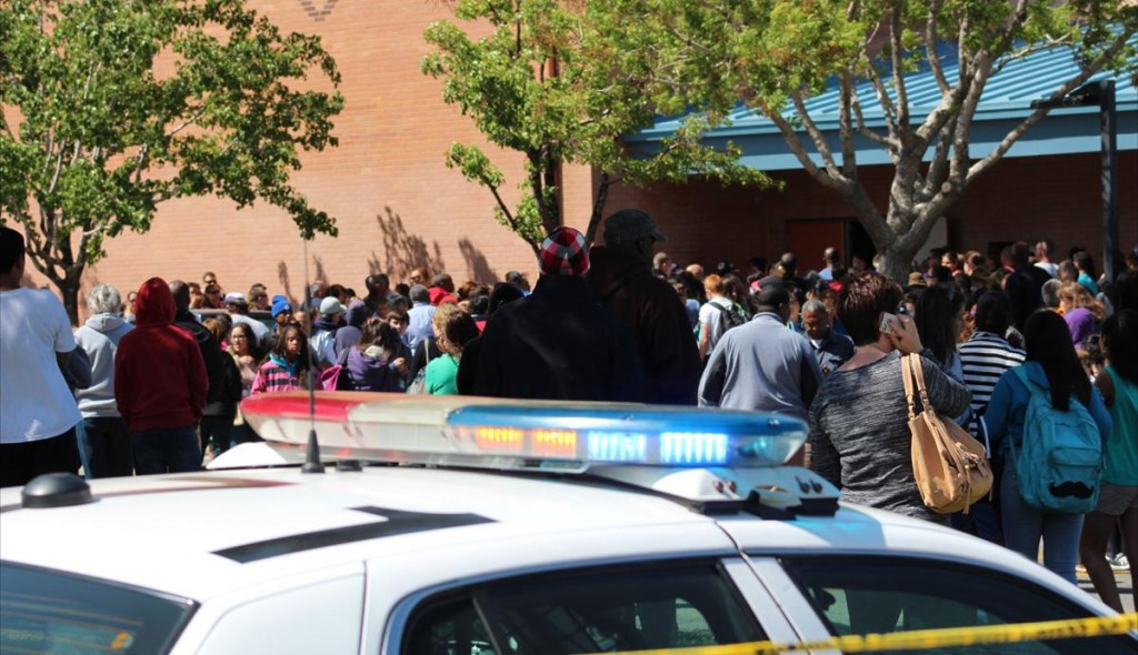 Frantic parents crammed the entrance of Hillview Middle School Monday afternoon as deputies stood guard. Deputies were searching for a 13-year-old student who was depresses and believed to be armed with his father's firearm. (Photos by TONY CHEVAL)