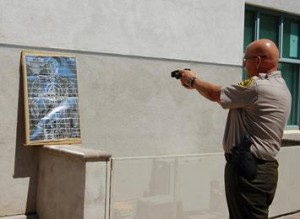 Deputy Michael Rust demonstrated the power of the new Tasers.